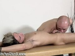 Nude men Brit twink Oli Jay is corded down to the table, his slick